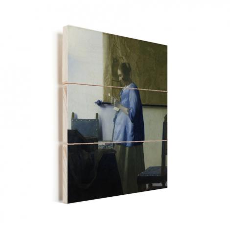 Brieflezende vrouw in het blauw - Schilderij van Johannes Vermeer Vurenhout met planken